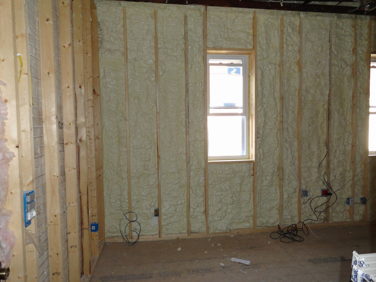 Spray foam insulation spf on masonry wall in ownesville for Stone wall insulation