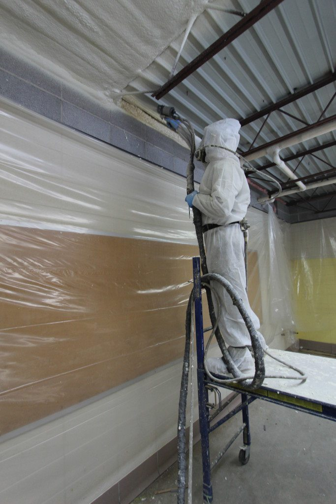 Spray foam quickly expands, filling all gaps and voids. Here, Foam Engineers is sprays foam in the gap between the wall and the ceiling, creating an air seal. Creating an air barrier prevents air infiltration and exfiltration.