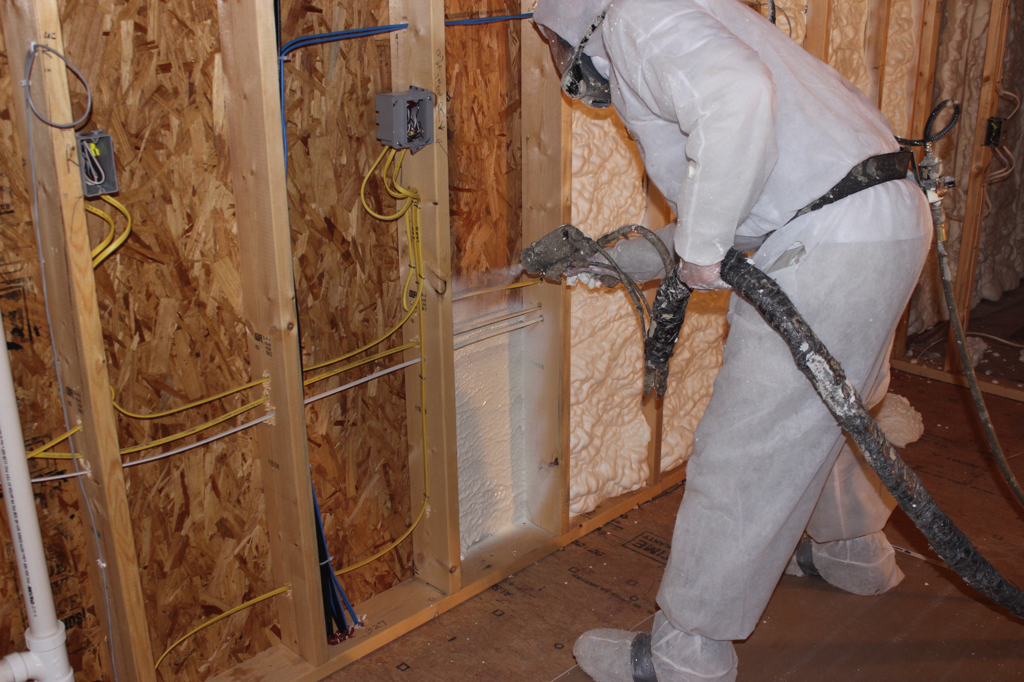 Foam Engineers Applies Spray Foam Insulation Behind Wiring